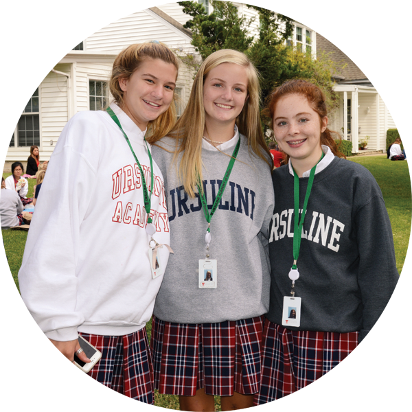 Three Ursuline academy of Dallas Students posing for a picture.