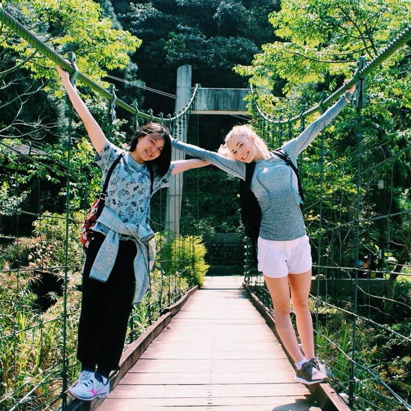 Ursuline academy students on a bridge in Taiwan.